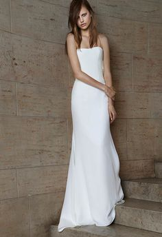 Vera Wang Spring 2015 Bridal Collection - Ivory strapless soft mermaid silk crepe gown with cut-out back and cowl detail.