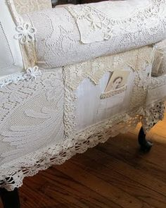 ...old chair upholstered with vintage tablecloths using hot glue gun, lovely!