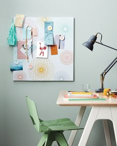 Practical can be pretty, too: This magnet board brings order and style to a home office or kitchen. It's made by covering two rectangular metal boards (joined together to make a square shape) with a decal that's sized to fit. Make matching magnets by adding smaller stickers to flat round magnets. Spontan magnet boards and magnets, ikea.com USA OK chair, michelevarian.com Original 1227 brass desk light, in Elephant Gray, shophorne.com Stash desk, in White Ash/ White, bludot.com