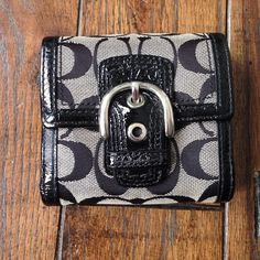 Coach wallet Cute and classy! Black and grey Coach wallet. In excellent condition! See my closet for the matching Soho bag! Coach Bags Wallets