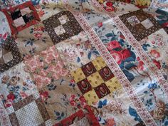 "Detail - Antique Chintz Quilt Top C 1830 Very Pretty Fabrics | eBay seller annacottage; unused, chintzes still have their glaze, all hand stitched, based on fabrics and patterns, seller is estimating it was made c. 1820; overall bright & clean appearance, some light brown water stains, 53"" x 81"".  [It's an odd looking quilt.  Don't know what to make of it.]"