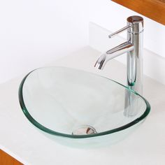 Elite Mini Tempered Glass Bathroom Vessel Boat Shaped Oval Bowl Bottom Sink and  Pop-up Drain and Mounting Ring - Bring some character to your already chic bathroom! This tempered glass boat shaped bowl bottom vessel sink, a smaller version of an Elite sink model, can spruce up even the smallest of spaces. Paired with a pop-up drain and mounting ring, this centerpiece can tie in with the rest of the fixtures you may have in your bathroom. New technological procedures include laser guided…