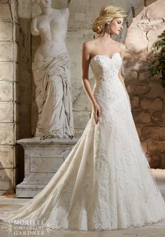 Wedding Dresses 2779 Crystal Beaded  Alencon Lace Appliques on Net Over Chantilly Lace with Scalloped Hemline Lace