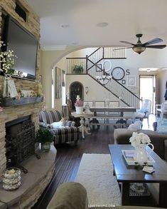 A Place for Everything home black white stairs decorate living room mantle woodstove flatscreen