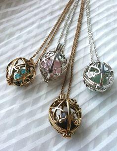 Caged bead pendants