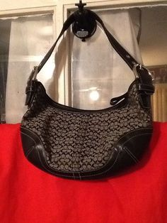 """COACH BLACK SIGNATURE HOBO HANDBAG #K3K-6351 EUC      100% AUTHENTIC COACH HOBO HANDBAG, SIGNATURE small C's measuring10.5"""" x 6.5""""            Exterior– very light wear, surface scratches on bottom. Handles are Nickel silver embossed hardware.Coach signature canvas is invery good condition, clean.THERE IS NO COACH HANG TAG FOR THIS BAG.    Material: Jacquard & Leather    Color: Black        MEASUREMENTS(APPROXIMATELY)    Size: I consider this bag to be small    LENGTH: 10.5""""…"""