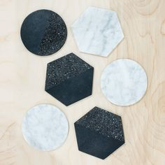 La Piedra Coasters.Hand-carved in jet-black volcanic rock and white marble stone, these handsome devils take several days to complete. Each one is made start-to-finish in a fair trade environment in a design studio in Tonalá, Guadalajara. $55