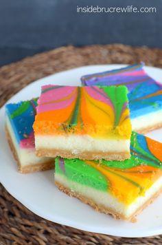 Rainbow Vanilla Cheesecake Bars - vanilla cheesecake with a fun rainbow swirl.  Fun, festive, and perfectly delicious!