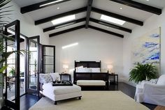 Suzie: Amazing bedroom with ebony box beams, vaulted ceiling, crisp white walls paint color, b ...