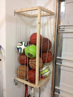 Ball Storage For The Garage And A Little Pail For Ball Needles And Pumps  Beneath.