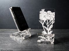 Acrylic Cell Phone Stand - 5 Sizes Custom Fit for iPhone 6, 6 Plus, iPhone 5, iPhone 4 and Universal Docking Station - Pod Flowers by PhoneTastique on Etsy https://www.etsy.com/listing/129717613/acrylic-cell-phone-stand-5-sizes-custom