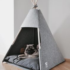 Handmade tent for a cat or a dog made out of gray felt with a soft cushion filled with siliconegranulate. Shape of the tent gives your pet the feeling of comfort and safety. Depending on the needs your pet can hide inside or keep an eye on the world outside. The cushion case (100% polyester) can be taken off and washed at 30°C. Poles are made from solid wood. Teepee dimensions: 60 x 60 x h 90cm.