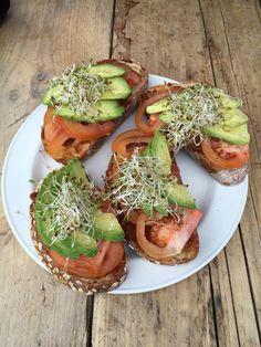 Sourdough toasties with The Happy Pear sun dried tomato pesto, avocado, tomato and topped with alfalfa.