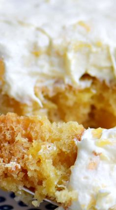 Practically Perfect Pineapple Cake ~ Loaded with pineapple flavor... Made without butter or oil, it's incredibly moist and topped with a delicious pineapple fluff frosting!
