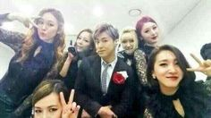 Of course... Mr. Suave-Yunho, has to be with 'the Ladies' in this pic. >< lol  Look how many of them all wanna 'hang around' next to him so close too. ;) <3  Hey...there's only ONE girl that needs to be next to him, and that's me! hahaha j/k *grrrrrr*