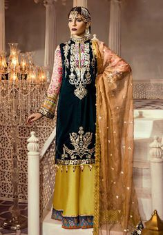 Fab Green Faux Georgette Embroider Work Pant Style Suit Make the heads flip whenever you costume up with this Green And Yellow faux Georgette pant style suit. The amazing dress creates a dramatic canvas with wonderful Embroider work. Bridal Mehndi Dresses, Eid Dresses, Pakistani Wedding Dresses, Pakistani Dress Design, Casual Dresses, Suit Fashion, Fashion Pants, Ladies Fashion, Designer Salwar Suits