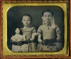 Exquisite portrait of 2 pretty young sisters wearing matching dresses and long black gauntlet gloves. The older sister has a cross around her neck and the younger sister is holding a Very Large Doll. Gauntlet Gloves, Daguerreotype, Vintage Photos, Sisters, Old Things, Dolls, Children, Pretty, Ebay