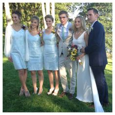 Custom ivory sheath wedding gown and bridesmaids dresses by Dahl NYC...