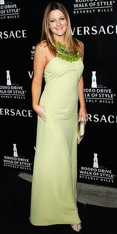 celery-green gown with an over-the-top embroidered neckline