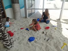 A big, indoor sandbox.  This was done with artificial sand--not sure of the pros/cons of real sand vs. artificial.  Fun for all ages.