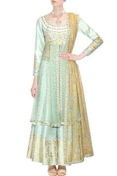 This Sharara set features a mint green anarkali kurta in dupion base with white yellow flowers embroidery on the yoke. The sleeves of this sharara set appliqued with sequins embellishment all over and