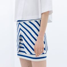 SALE ❄️ Zara // Blue Striped Skirt Super chic peplum striped skirt in royal blue and bright white... Perfect for any working woman! Waist: 14 inches. Length: 16 inches. Tagged: Trafuluc via Zara. Materials: 48% Cotton, 48% Polyester, 4% Elastane. Size Medium but fits as Small or a Women's 2-4. NWT - Never worn! SOLD OUT ONLINE! Zara Skirts Mini
