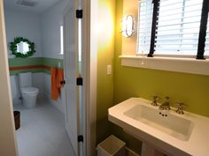 Inspired by additions made to New England cottages as families grew, the pedestal lavatory is positioned just outside the bathroom in the dressing room area from HGTV Green Home 2010.