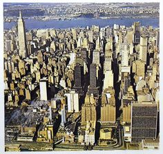 Aerial view looking west of Midtown Manhattan's 42nd Street (center), Murray Hill (left foreground) and Grament District (left background) aereas. Fall, 1970. The Empire State Building (Shreve, Lamb & Harmon, 1931) dominates the cityscape at left, background. At right, foreground is the 39-story U.N. Secretariat (Wallace K. Harrison, 1950) glass palace. Top, at right are the 77-story Chrysler Building (William Van Allen, 1930), the new 54-story One Astor Plaza (Der Scutt-Kahn & Jacobs, 1972)...