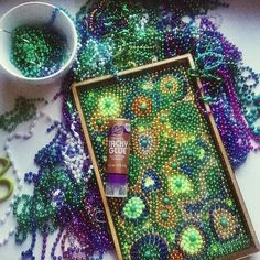 """This is my third tray made from mardi gras beads and #tackyglue. Like I needed another reason to collect sparkly things.""   --Aunt Peaches"