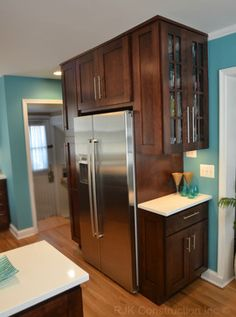 Love these color cabinets with a darker blue wall