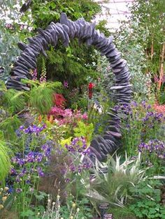 Garden arch... looks likes flat stones with a hole drilled through each one and strung on a round metal hoop.