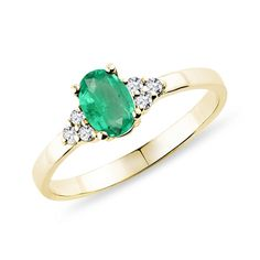 A gorgeous, romantic ring that features a gently enthralling emerald gem, which is emphasized by the sparkling white diamonds and yellow gold band. This ring is crafted in classic yellow gold. Green Rings, Yellow Gold Rings, Diamond Rings, Gemstone Rings, Emerald Gem, Rings For Her, Gold Wedding Rings, Inspirational Gifts, Gold Bands