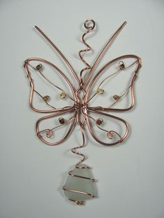 Copper wire butterfly ornament sun catcher, seaglass and Swarovski crystal, upcycled. $18.00, via Etsy.