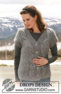 """Rozpinany sweter DROPS ściegiem ryżowym, z krótkim rękawem i warkoczami z włóczki """"Eskimo"""". Od S do XXXL. ~ DROPS Design"""