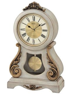Seiko Musical Mantel Clock This mantel clock features an antique, off white crackle finish and plays one of six melodies on the hour. Antique french styling with burnished. Seiko, Cogsworth Clock, Clock Face Printable, Pictures At An Exhibition, Girl Desk, World Clock, Wood Mantels, Mantel Clocks, Master Room