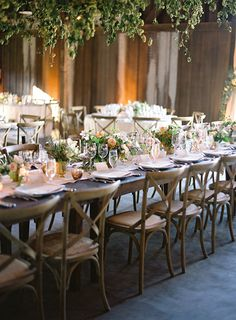 long reception tables with cross-back chairs