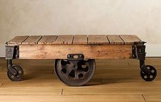Reclaimed Factory Cart Table - love the look of this. Plus, easy to move around. Now, where o where would I find the old rollers to do one myself...