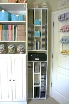 The top half holds all of my acrylic stamp sets (75 and counting!).  David installed adjustable shelving in the middle that holds baskets with ink spots, reference books, etc.  IT packs a lot of storage into a little space tht would normally have been neglected behind the door!