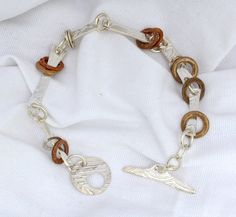 Mixed Metal Link Bracelet by JewelryByNadine on Etsy https://www.etsy.com/listing/193209693/mixed-metal-link-bracelet