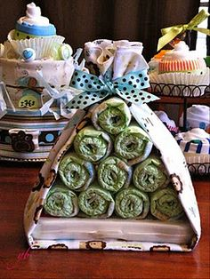 I made these for one of my good friends baby shower... A diaper cake, onesie cupcakes, and a stork bundle. So sweet!