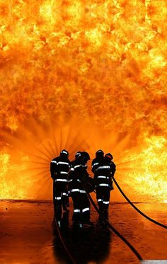 """Firefighters fighting fire... every time I see a firetruck my heart skips a beat. """"Go get them boys"""""""