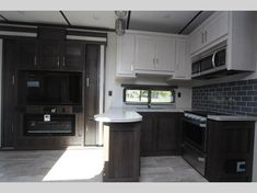 Keystone Raptor toy hauler 423 highlights: Outdoor Kitchen Separate Garage Loft Exterior TV Master Suite With this Raptor toy hauler, you will. Raptor Toys, Fifth Wheel Toy Haulers, Ocala Florida, Convection Cooking, Electric Awning, Keystone Rv, Grey Cabinets, Entry Doors, Motorhome