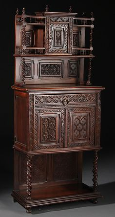 CONTINENTAL WALNUT SIDE CABINET, 19TH CENTURY, PROBABLY FLEMISH. In a Renaissance style, with elaborately carved panels in medium and deep relief, comprising a two tiered top section with central door above a two door cabinet with rosette carved drawer front.