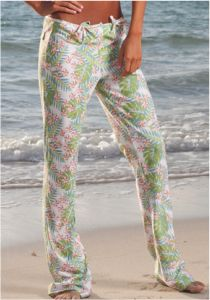 Whitecap Plumeria Beach Hipsters      Cut close and with a low rise, these silky spandex hipster trousers are perfect to slip on after sun or surf.  Two bow-tied openings on each hipbone with back pocket tabs, slightly flared ends.  In white background floral plumeria print.