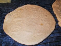 A pre-baked sourdough pizza shell, ready for topping