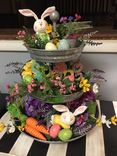 My Spring & Easter metal tier tray decor..cute bunnies, eggs, carrots, flowers. Fun to change out for the seasons.