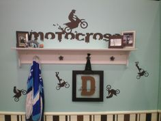 "Great Boy room!!!! UL stock Motorcross design above the shelf. Two different embellishments placed differently for movement under the shelf. UL frame with plexiglass. Custom ""D"" and name from the MyDesign Suite at my UL website (http://chrisa.uppercaseliving.net)"