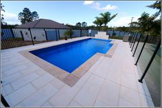 Photo displays fibreglass inground lap pool in a backyard pool setting with glass pool fencing and sandstone look pool pavers Diy Swimming Pool, Fiberglass Swimming Pools, Swiming Pool, Glass Pool Fencing, Pool Fence, Pool Pavers, Family Pool, Plunge Pool, Pool Ideas