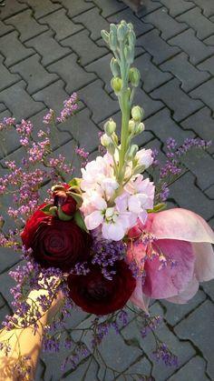 Early spring quickie flower arrangement. Ranunculus, matthiola, magnolia, surrounded by limonium.