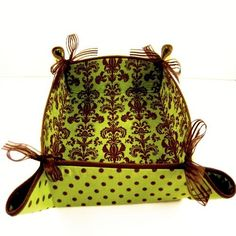 Apple Green and Chocolate Brown Fabric Basket, piped in brown and tied with translucent ribbons.  Just right for Mother's Day.